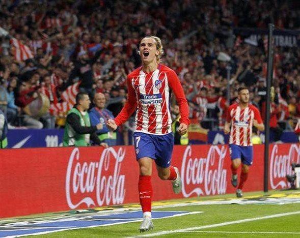 Antoine Griezmann célébrant un but avec l'Atlectio de Madrid en champion's league